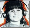 The author aged 5, wearing massive earphones